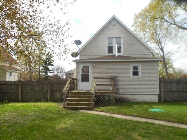 Single Family Homes en 107 W 5th Street Aroma Park, Illinois 60910 Estados Unidos